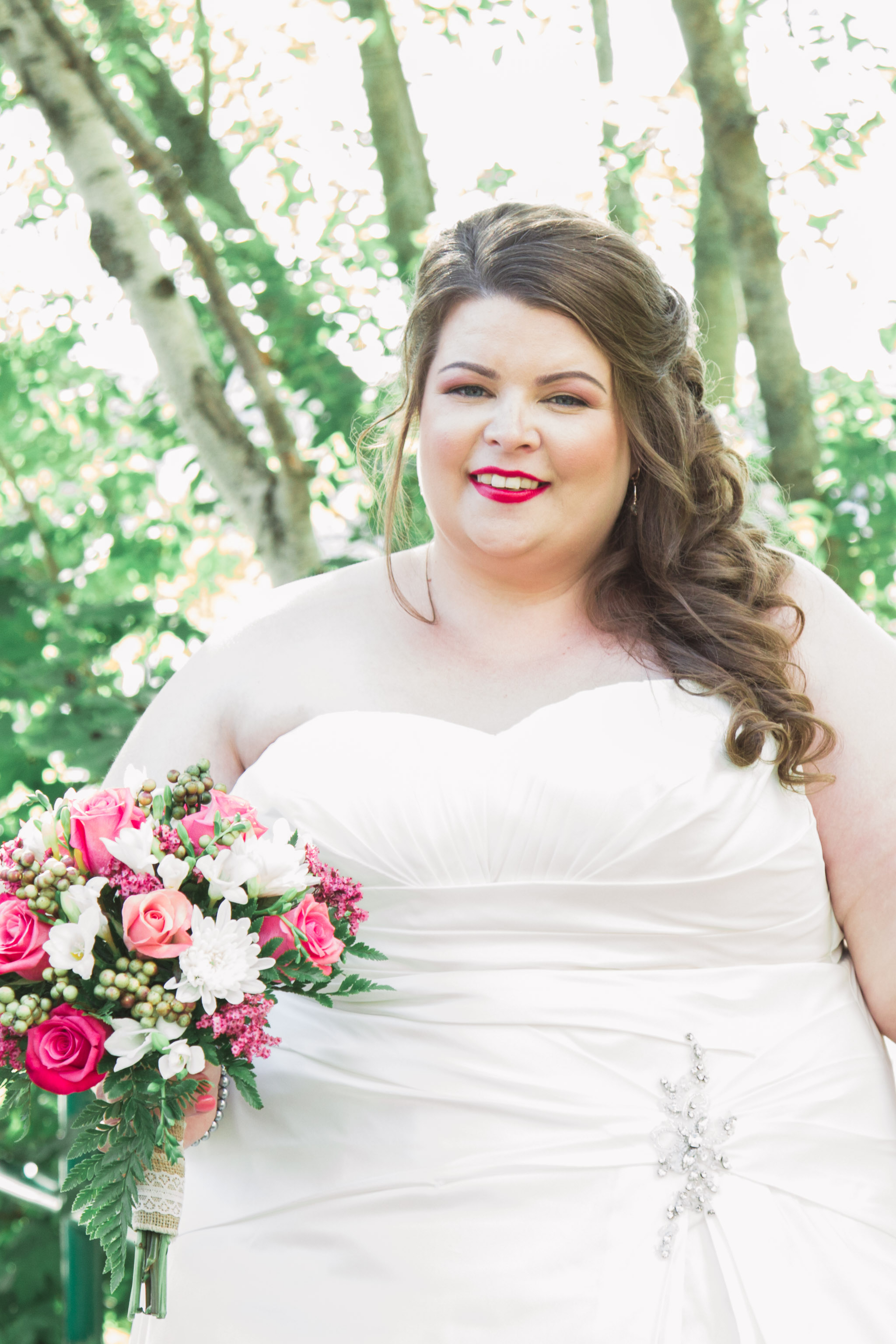 Image of bride smiling for photographer