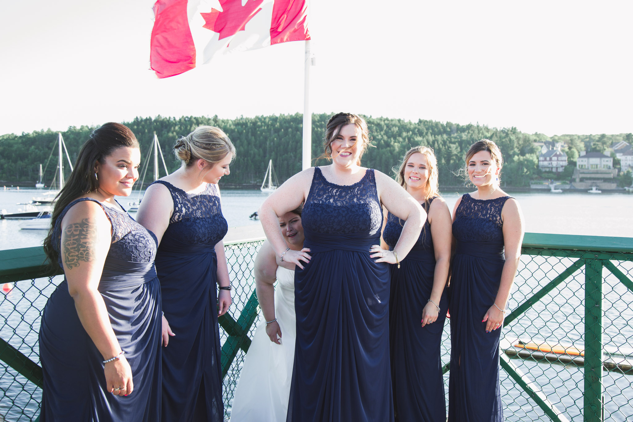 Image of bride and her bridesmaids posing