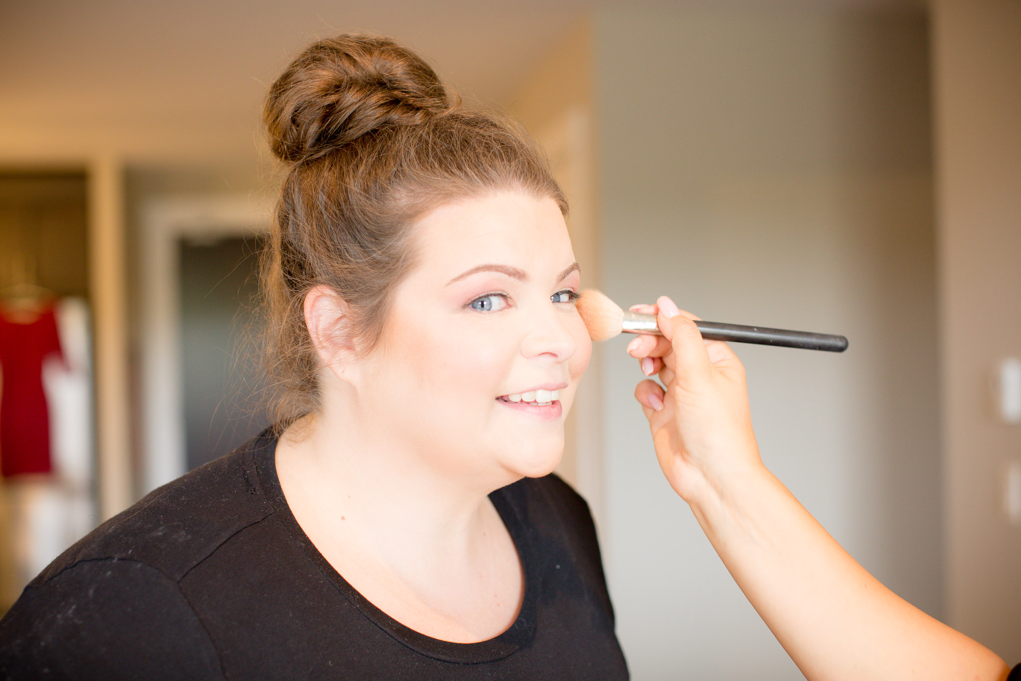 Image of girl getting her make up done