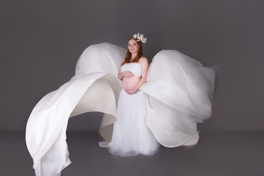 Image of pregnant woman from fine art maternity session with flowing white outfit