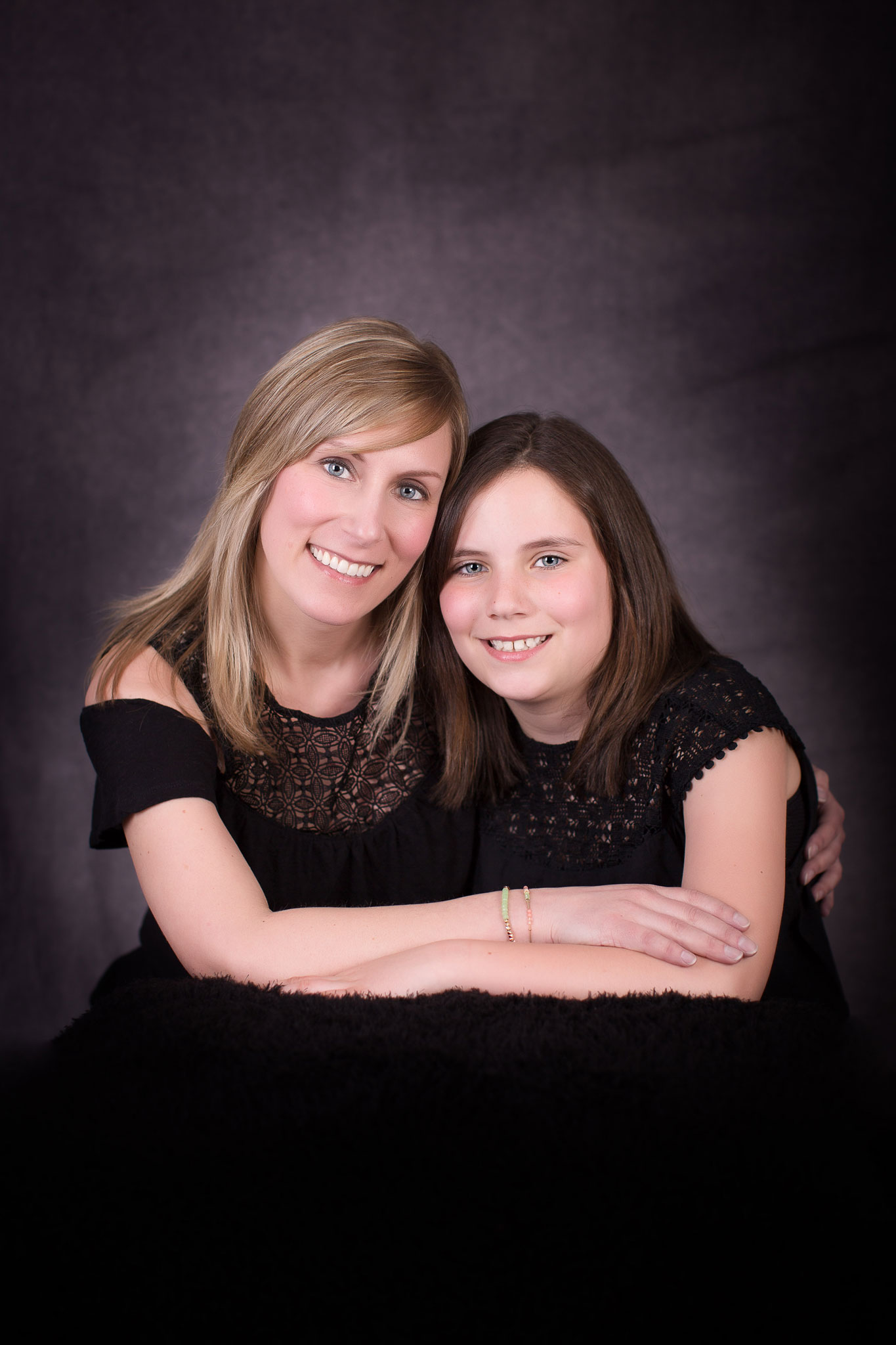 Mother and daughter posing for family session