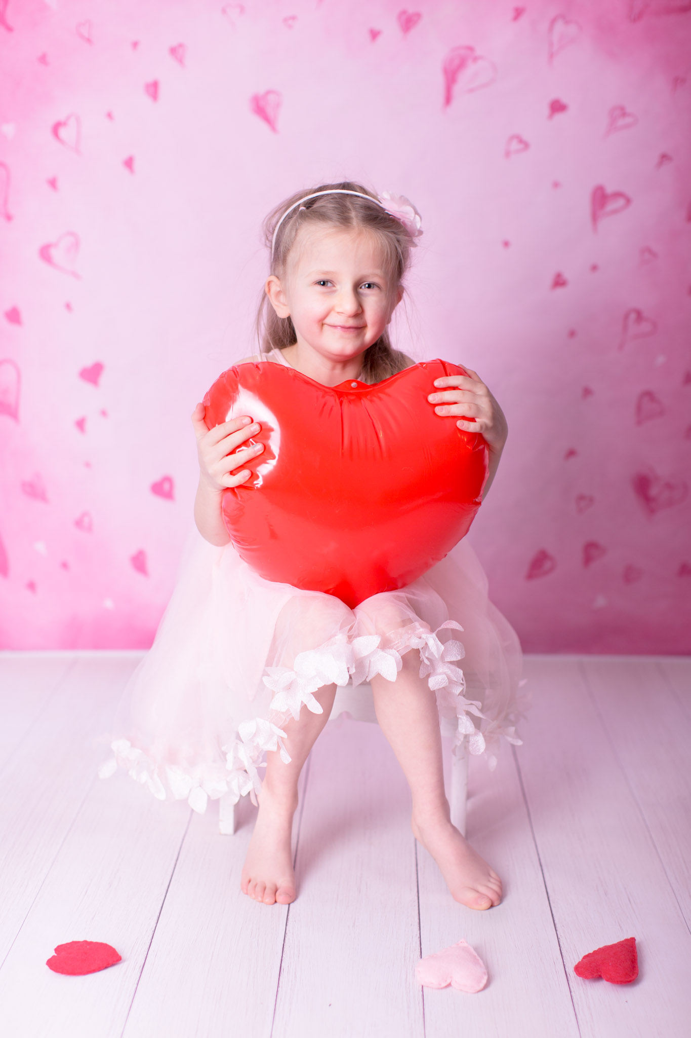 Image of the girl holding balloon heart