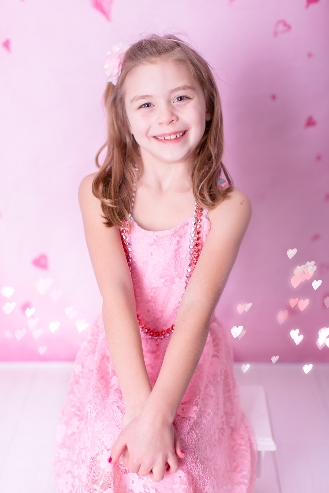 Image of the girl smiling and posing for valentine's day sessions