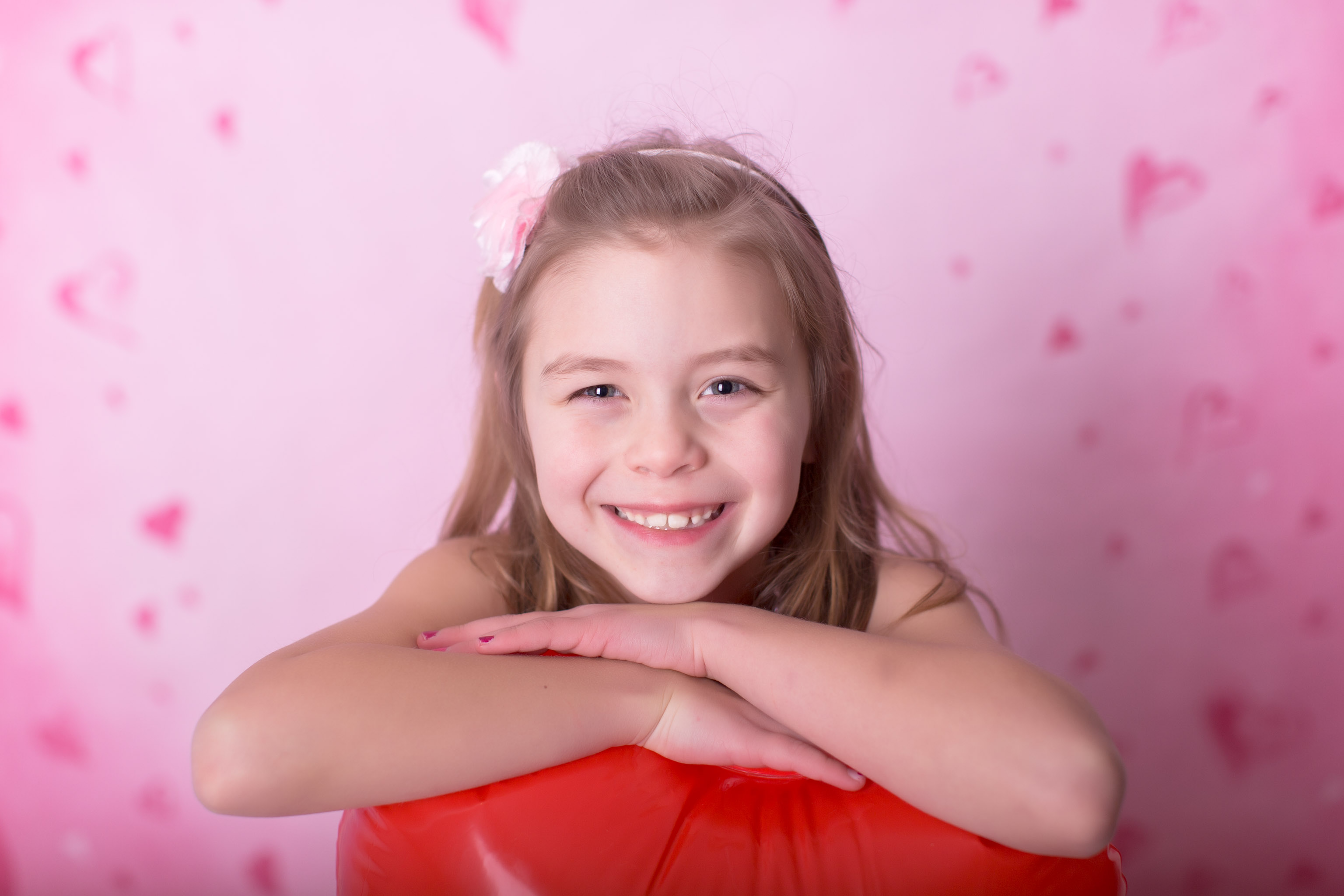 Close up of a girl posing for valentine's day session