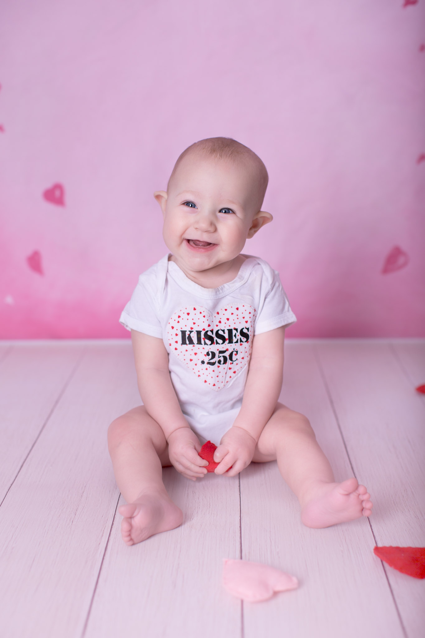 Image of the baby smiling sitting on the floor