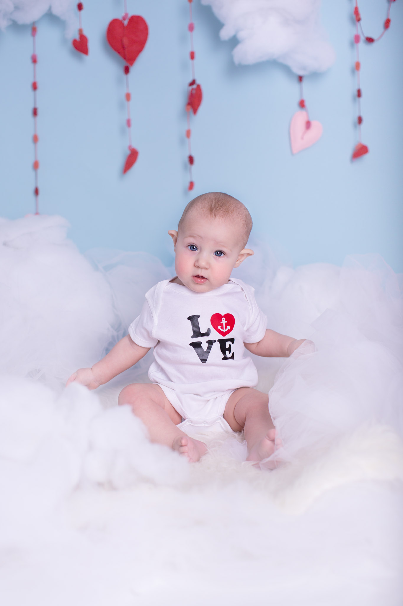 Image of baby sitting on the set from Valentine's day sessions